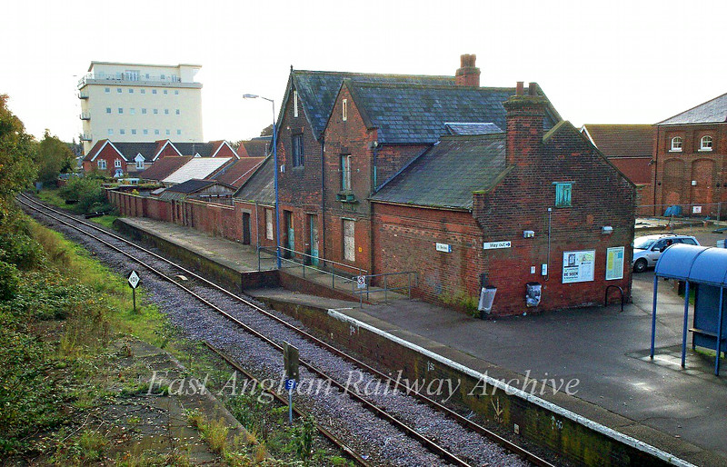 Beccles Station buildings.  1st October 2008. The 101 diamond shaped sign at the left hand  side of the track is a channel change marker board to instruct drivers to change radio channels on the Radio Electronic Token Block signalling system. Channel 101 is Transmit from train 197.15 Mhz, Receive   on 205.15 Mhz.