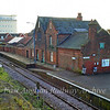 Beccles Station buildings, built by the Halesworth, Beccles and Haddiscoe Railway. The 101 diamond shaped sign at the left hand  side of the track is a channel change marker board to instruct drivers to change radio channels on the Radio Electronic Token Block signalling system. Channel 101 is Transmit from train 197.15 Mhz, Receive   on 205.15 Mhz.  30th October 2009
