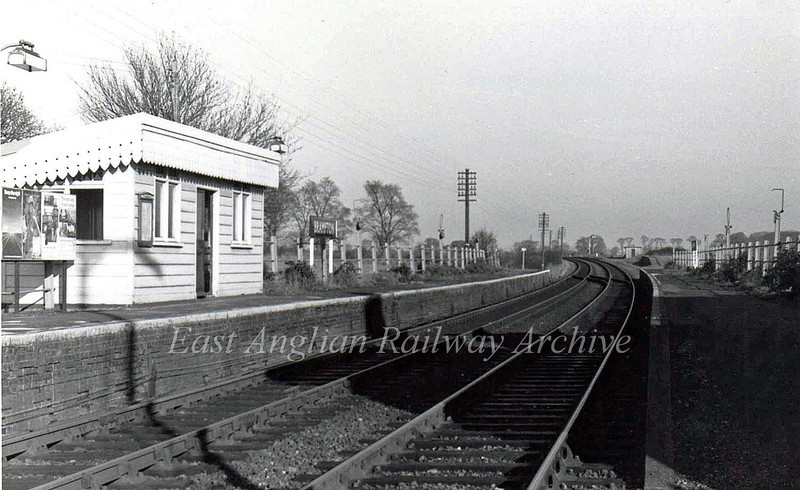 "Brampton on 24th September 1975, facing Beccles.The down platform with the shelter has now been demolished, but the shelter has been rescued and now resides at The Mangapps Museum at Burnham on Crouch.  <a href=""http://www.mangapps.co.uk/"">http://www.mangapps.co.uk/</a>  The shelter was originally from Great Ormesby station in Norfolk on the M and GN."