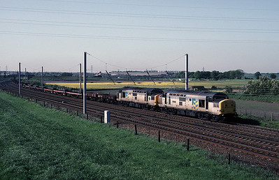 37197 37293 with a southbound steel train (Mossend Margam?) at Winwick Jct 18/5/92