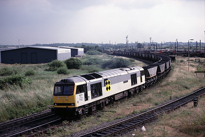 Shiny new 60071 brings loaded MGR train for Fiddlers Ferry from Arpley yard  26/6/92