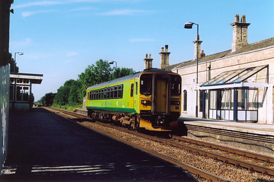 Market Rasen, early morning. 153385 pauses at the deserted station with 2T11 0746 of Newark North Gate to Grimsby.  27/6/2005