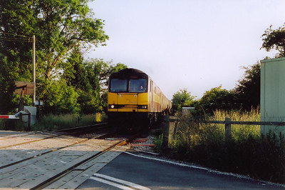 EWS 60021 passes over River Witham with 25 empty TEA bogie tanks running back to Lindsey. The train is 6E82 1251 off Rectory Junction, the last shot of the day.  27/6/2005