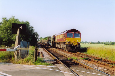 On the line between Lincoln and Newark, 66114 passes Winthorpe level crossing with a Permanent Way train.