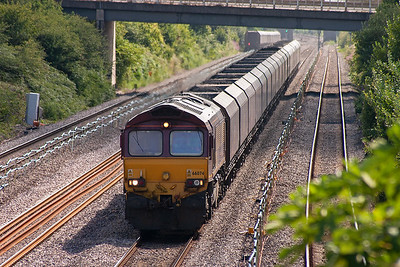 With the tail of the previous train visible in the background, 66074 approaches with a loaded rake of HTA coal hoppers. The train is 6B68 0926 Avonmouth Docks to Aberthaw Power Station.