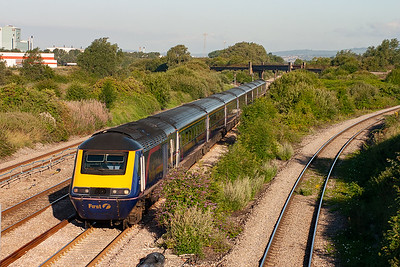 It is about 7.20 in the morning and the sun is shining warmly as 43181 leads 43127 past Llandevenney with 1L20 0600 off Swansea to London Paddington.
