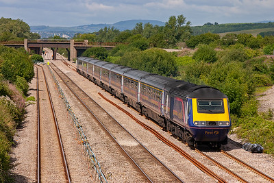 This HST set has been seen earlier this morning. The sun has come round to light the side of the train nicely. 43015 and 43179 power east with 1L48 0930 Swansea to Paddington. It passed by 2 hours and 15 minutes previously.