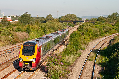 An unknown class 220 Voyager unit passes by Llandevenney with 1E37 0700 Cardiff to Newcastle cross country service. The only VXC working from South Wales.