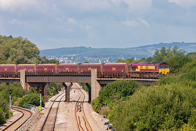 With the sun shining warmly 66121 crosses Bishton Flyover with the early running 4C55 0858 Aberthaw Power Station to Avonmouth Docks empty coal train.