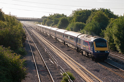 Looking east into the bright and warm morning sun with 43179 leading a Bristol Temple Meads to Swansea HST. Train 1B02 left Bristol at 0703.