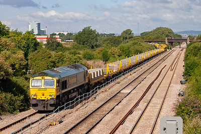 On the rear of the train is Heavy Haul sister 66617, shut down.