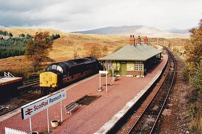 A Sunday drive with my young son Ross found us at the end of a 20 odd mile long cul-de-sac!  Rannoch station is at the end of that road and it is deep in Rannoch Moor.  A well timed surprise is 37401 heading south with a ballast train.  14/10/1990