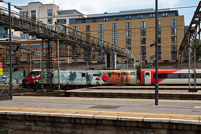 """91111 has been vinyled with poppies and silhouettes of soldiers of The Great War and carries the name """"For The Fallen"""".  It was carried out as part of the celebrations for the centenary of the Armistice in 2018.  The working is 1D18 1333 Kings Cross to Leeds."""