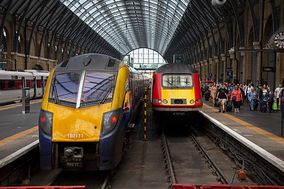 Former Great Western class 180 Adelanti unit 180111 is now operated by Hull Trains and will shortly depart Kings Cross for that city running as 1H04 1348 off.  Next to it is 43290 which has just arrived from Edinburgh having departed at 0930 as 1E09.