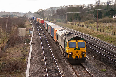 A well loaded freightliner from Southampton to Lawley Street comes by during a period of cloud. The service, 4M55 0858 off, is rostered to a work stained 66537.