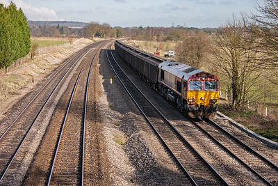 A late running freight approaches on the up relief road. 66123 works 6L46 2341 Bridgend to Purfleet Ford parts train. It is running over 5 hours late.