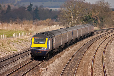 The second up service off Weston Super Mare nears the overbridge at Lower Basildon with powercars 43139 and 43125 on 1A12 0930 off to Paddington.