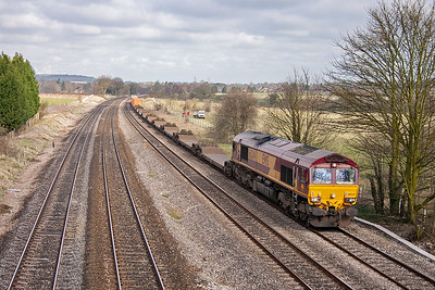 EWS have made inroads into Freightliners core business and operates container trains of their own, they call them Intermodals. 66244 forges on for Southampton with 4O53 0430 Wakefield Europort to Southampton.
