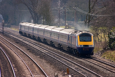 43172 leads a Paignton bound train with power on over the level grades at Lower Basildon, a few miles from Goring and Streatly station. This was the location of the Goring water troughs. This HST set would not be using them as it approaches with 1C24 1030 Paddington to Paignton.