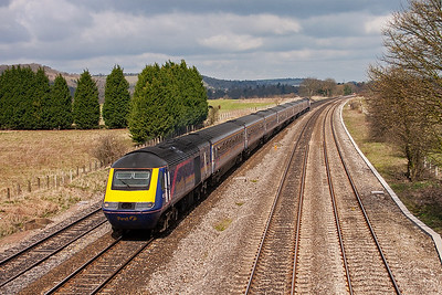 An unidentified HST set tears along the up fast with a working from west Wales. The train details are 1L40 0730 Carmarthen to Paddington.