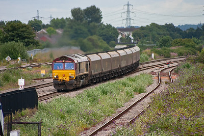 66063 has brought its 19 loaded HTA coal hoppers through the Severn Tunnel and up the 3 mile 1 in 90 climb from the bottom. This is 6B85 1344 Avonmouth to Aberthaw Power Station conveying imported coal.