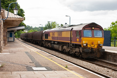 66018 wheels through Chepstow station with a mixed rake of BYA and JSA covered steel wagons on 6V05 0939 Round Oak to Margam empty steel.