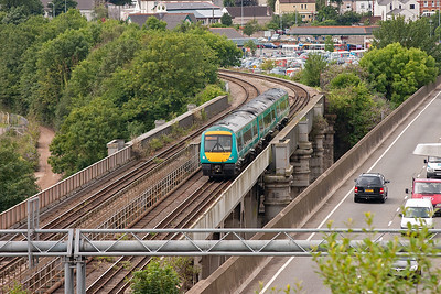 Seen from Chepstow's Beachley Lane is 170110 crossing out of Wales and into England on the inverted box girder bridge BR built in 1962 to replace Brunel's original 1852 tubular suspension bridge over the River Wye. The train is 1M62 1045 Cardiff to Nottingham.