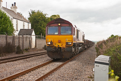The sun had gone by the time the first of the day's freight action appeared. 66124 passes the site of Woolaston station, which closed on 1/12/1954, with 6V35 0050 Lackenby to Llanwern loaded steel slabs.