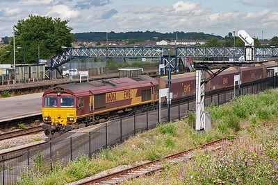 66063 and its rake rumble through the station.