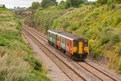 Whilst the main line is dropping the former branch to Monmouth Troy has been climbing from the junction and is at the top of the bank above 150267.