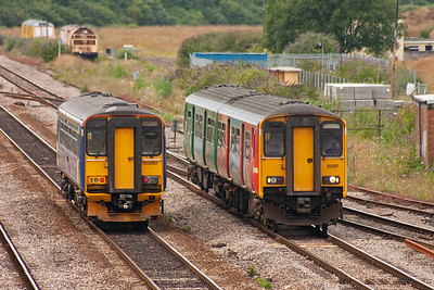 On the left is 153310 accelerating away from its station stop working 2L61 1438 Gloucester to Maesteg. On the right is 150267 slowing for its stop on a Maesteg to Gloucester working, 2G62 1417 off.