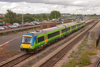 Turbostar 170633 wears the more usual colours of Central Trains and is working 1M73 1545 Cardiff to Nottingham. The set speeds through the station with its large island platform devoid of passengers.