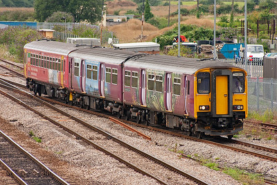 A pairing of class 150 and 153 sprinters slow for the STJ station stop enroute to Taunton from Cardiff 1500 off, 2C79. The units are 150248 and 153370.