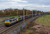 Autumn colours  are in evidence - even if the sun isn't  !   90047 and 90049 appear round the curve a Winwick  10 November 2018