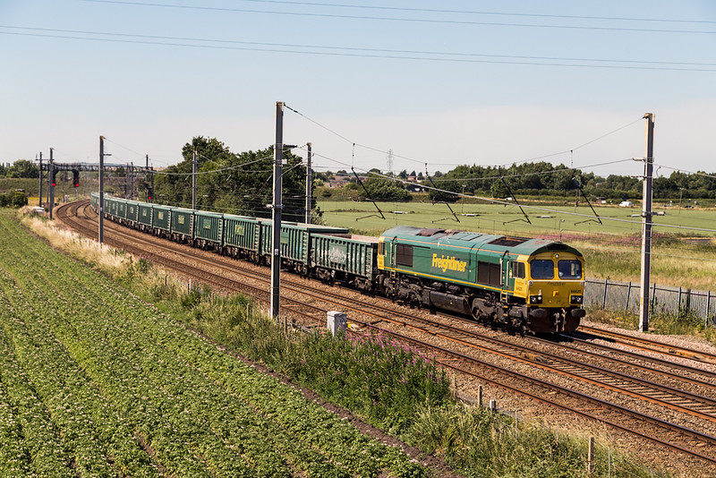 Sun is high and harsh as 66620 passes Winwick with 6H51 Hardendale to Tunstead empty box waggons 30 June 2018