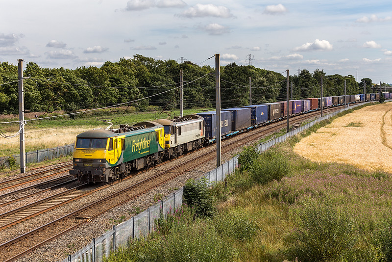 4S44 Daventry Coatbridge and a pair of 90s - 90047 and 9004s pass Winwick  4 August 2018