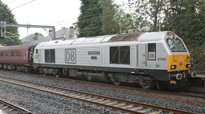 67 029 Royal Diamond, in silver livery, leads the Network Management Train through Hillington East