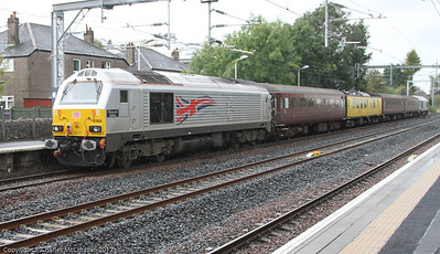 67 026 Diamond Jubilee, in silver livery, brings up the rear of the Network Management Train as it passes through Hillington East