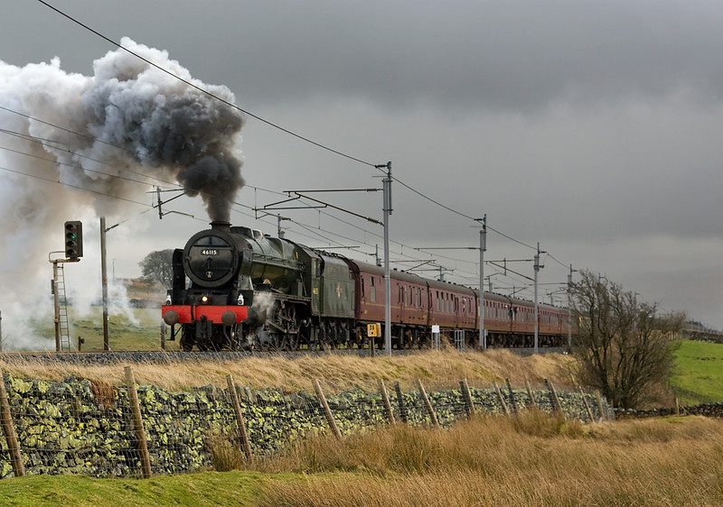 After weeks of frustratingly poor weather - I just had to get out.   The weaher was typical Shap - horizontal rain with few bursts of sun .   46115 Scots Guardsman puts in a sterling effort at Salterwath on the Cumbrian Mountain Express - 22  February 2014