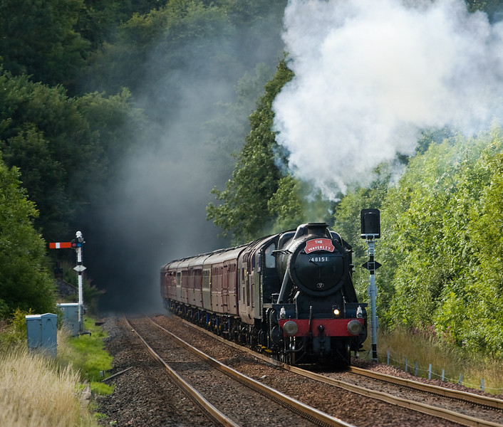 8F 48151 leaves Culgaith tunnel behind, ( the head-on shot not quite concealing the assisting class 37) 18 August 2013