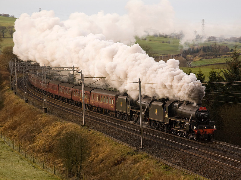 "By the time the trian past Lancaster there was a fair amount of  hazy high cloud.  44871 and 45407 at Hardrigg with Manchester - Carlisle  ""The Waverley""  28/1/12"