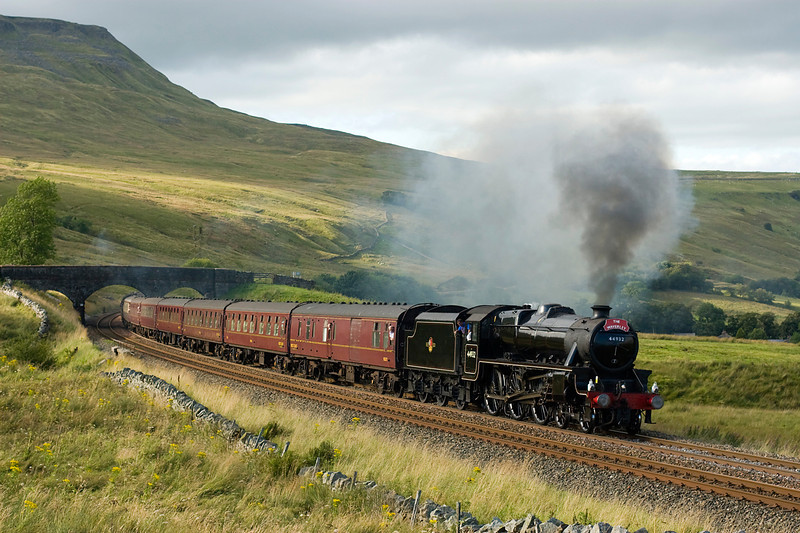 "Minutes earlier I had been standing in full sun.   The light was just beggining to come back as class 5 no 44932 takes ""the Waverley"" past Ais Gill on 3 September 2012."