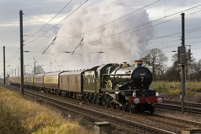 5043 Earl of Mount Edgcombe is still working hard as it draws to end of its journey to York from Tysleye passing Copmanthorpe.   14 December 2013