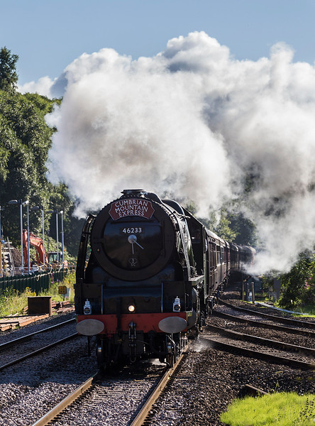 46233 crosses the junction with the line coming from Wigan to Westhoughton at Lostock Junction leading the Cumbrian Mountain express on 5 August 2017 - with the wires going up this scene will change.   A the time of the photograph, this was the only stretch of line round here without the masts in place.   On the left is construction associated with (I am lead to believe) an electricity substation