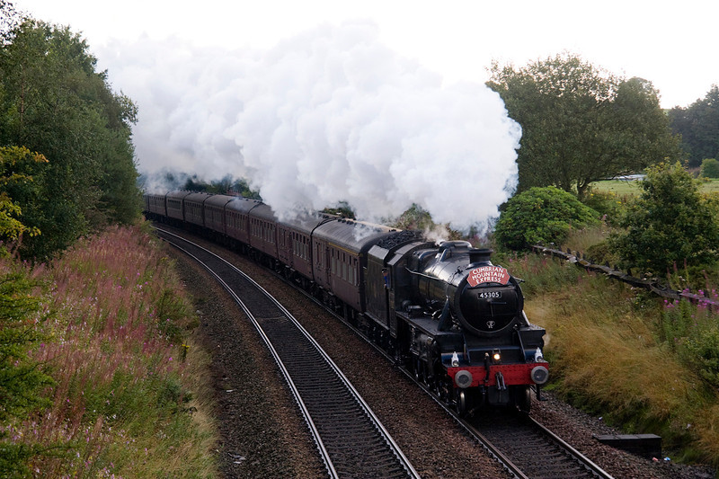 A hint of Autumns as 45305 heads away from Lostock Junction with the Cumbrian Mountain Express on 27/08/11