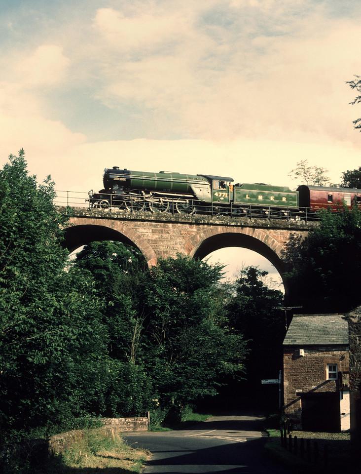 V2 4771 Green Arrow Crossing Gelt Bridge with returning Newcastle Carlisle excursion 20/7/86