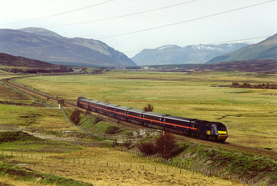 GNER's long distance Inverness to Kings Cross working passes Crubenmore with Dalwhinnie just visible in the far distance. The train ID is 1E10, 0705 off Inverness.  A passing loop and signalbox once stood here.  11/5/1998