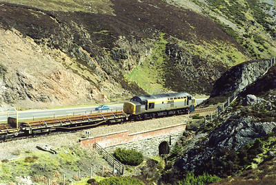 The engineers train fronted by 37175 starts the descent from Slochd to Aviemore, initially at 1 in 70.