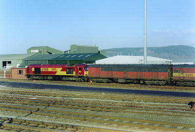 The daily Mossend to Inverness vans have been unloaded and are shunted back by 67008 prior to it running round them.