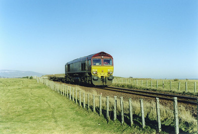 From Helmsdale to the Mound, the railway follows the coast. 66103 is seen for the last time just to the south of Brora.